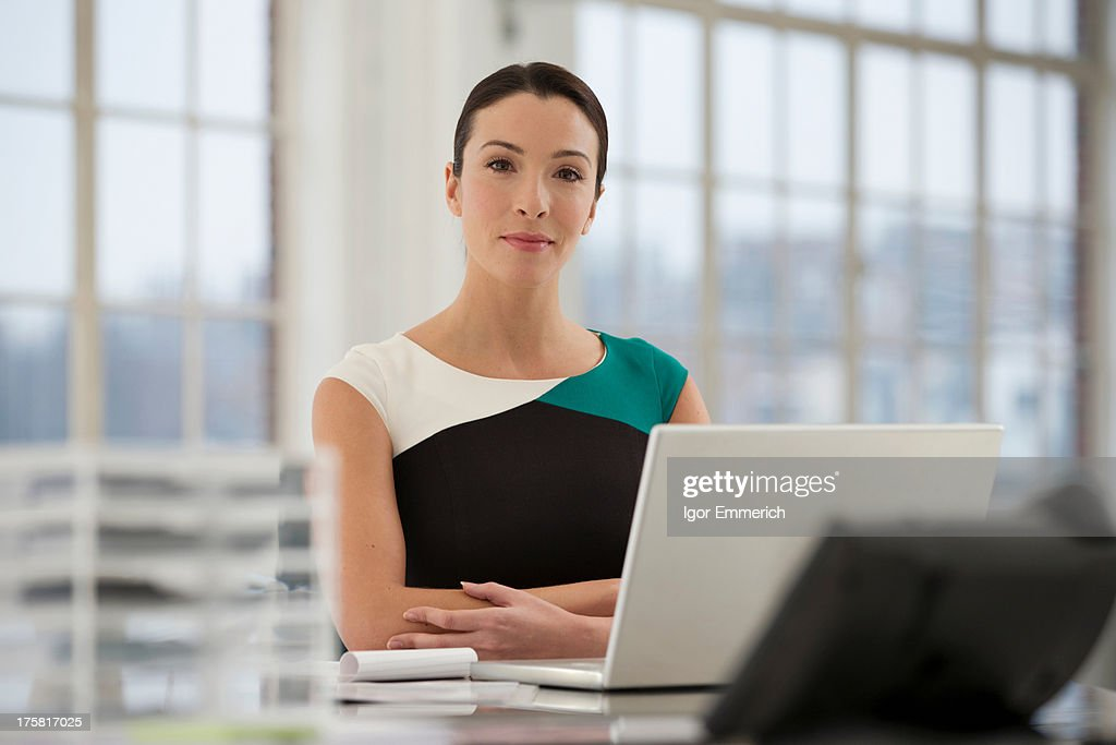 Female office worker using laptop : Stock Photo