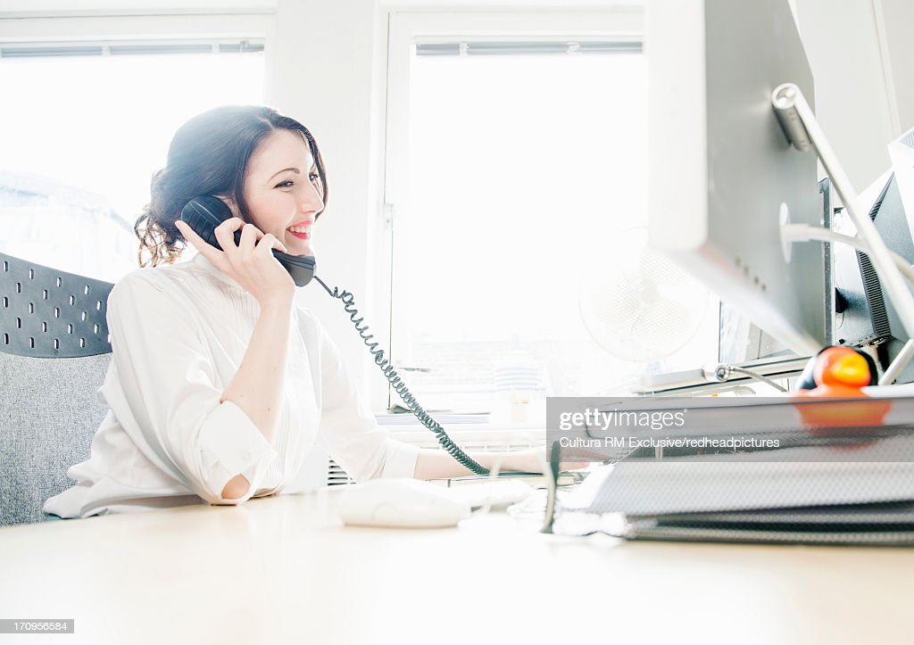 Female office working on telephone