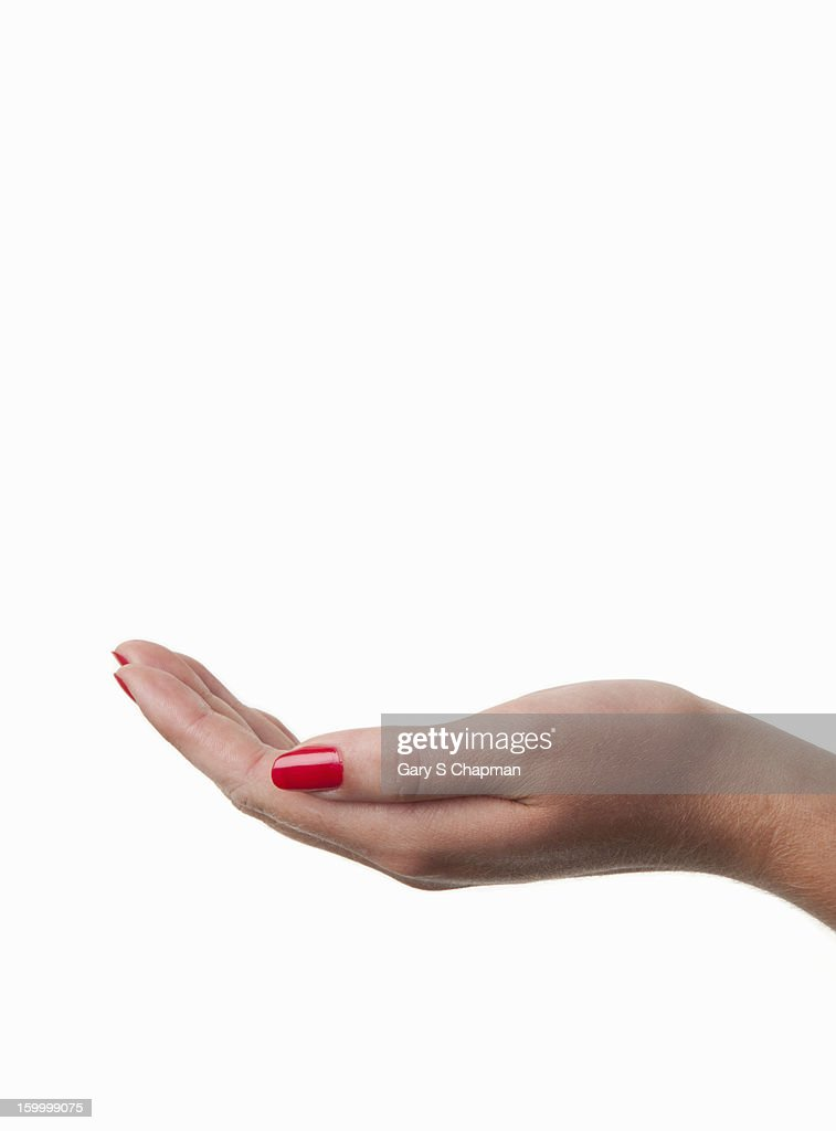 Female open hand with red nail polish : Stock Photo