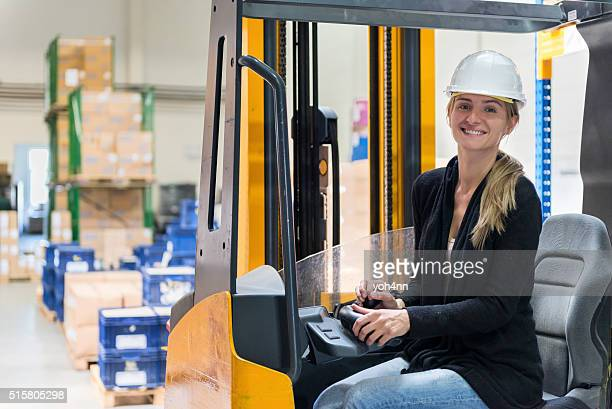 Female operator in warehouse