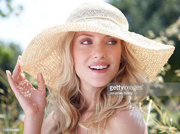 Female outside wearing summer hat.