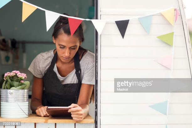 Female owner using digital tablet in food truck