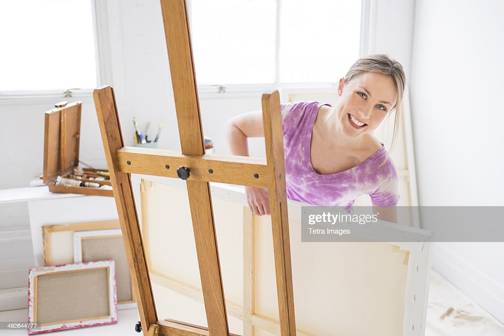 Female painter in studio, Jersey City, New Jersey, USA : Stock Photo