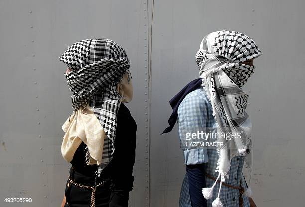 Female Palestinian students from Palestine Polytechnic University stand during a protest against Israel near the Jewish settlement of Beit Hagai at...