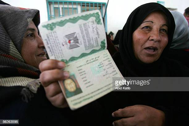 A female Palestinian traveler shows her passport as she waits to leave the Gaza Strip for Egypt at the Rafah border crossing November 23 2005 in the...