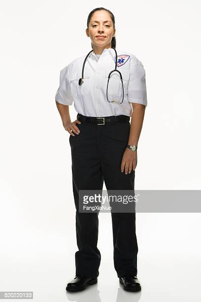 Female Paramedic on white background, portrait