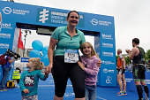 A female participant of the sprint distance is happy with her children after the finish at the ITU World Triathlon Hamburg on July 16 2016 in Hamburg...