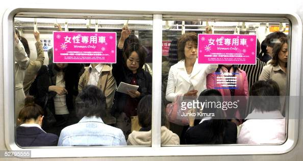 Female passengers board a 'Women Only' carriage at a metro station on May 11 2005 in Tokyo Japan Nine private railways and subway trains operated by...