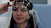 Female patient getting EEG exam