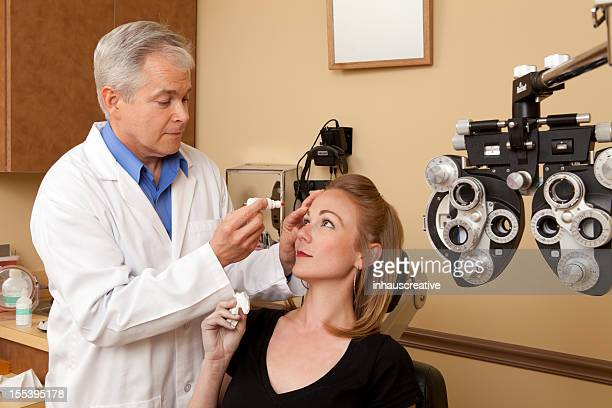 Female patient getting eyes dilated with medicine