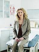 Female patient in medical room, smiling, portrait