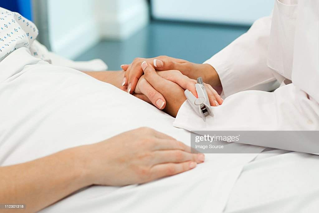 Female patient with doctor : Stock Photo