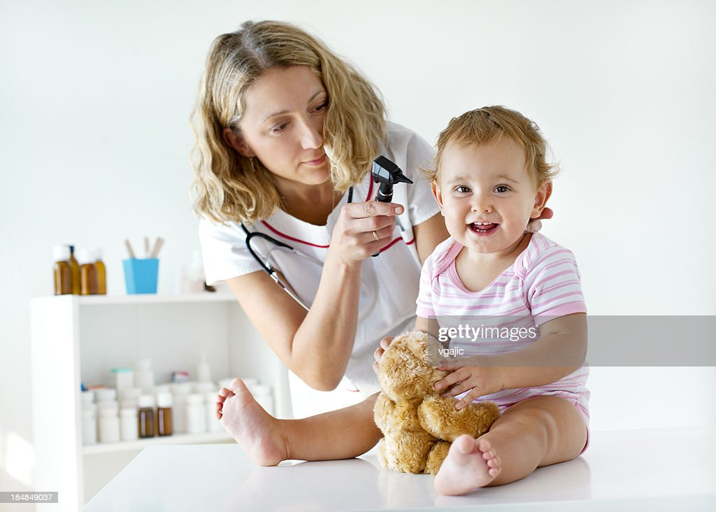 Female Pediatrician Doing Ear Exam of Baby Girl Patient