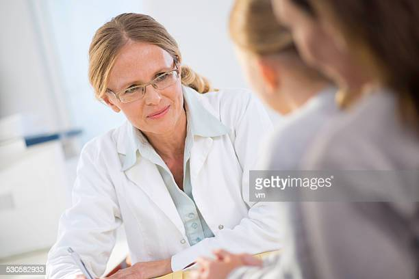 Female Pediatrician Talking with Little Patient