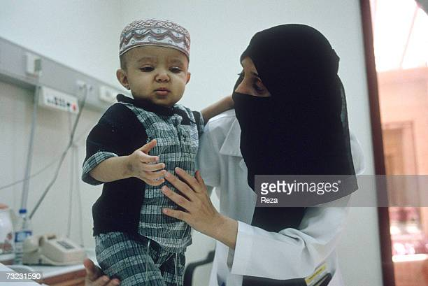 A female pediatrics doctor treats a young patient at King Khalid National Guard Hospital situated 30 km South of Jeddah Whether wealthy or poor Saudi...