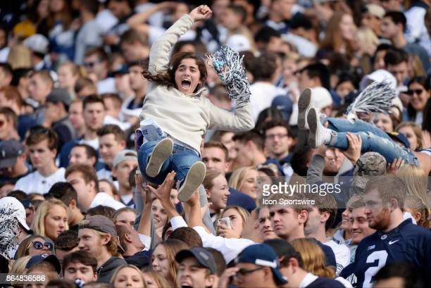 A female Penn State fan in the student section is lifted and thrown in the air after a touchdown The Penn State Nittany Lions defeated the Indiana...