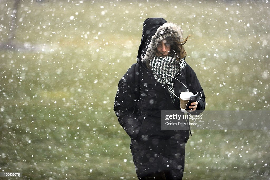 A female Penn State student fights the wind and snow as she walks along Bigler Road, on the Penn State campus, Thursday, January 31, 2013, in State College, Pennsylvania as severe wind and heavy snow squalls moved through Centre County.