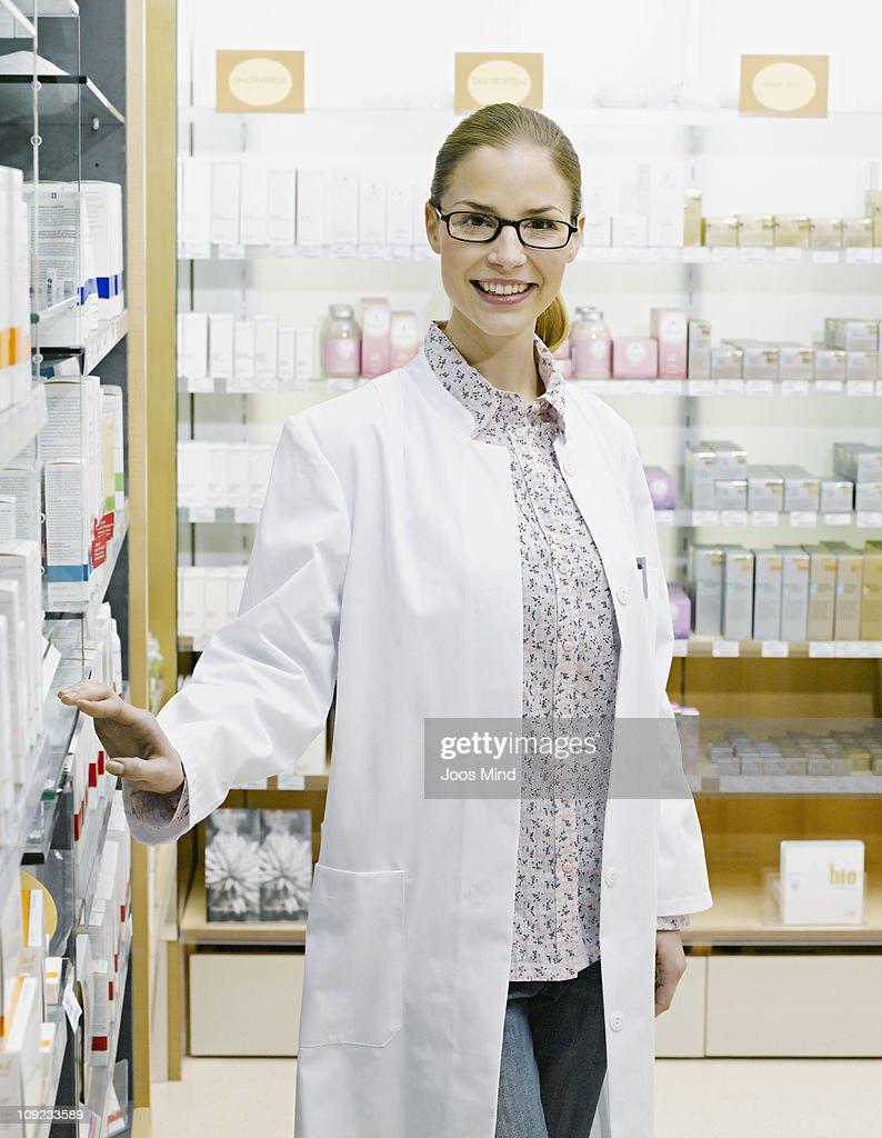 female perfume shop assistant, smiling, portrait : Stock Photo