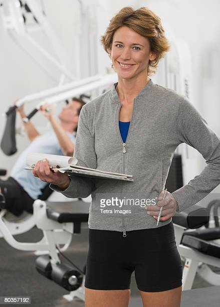 Female person trainer holding chart