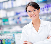 Female pharmacist at the drugstore
