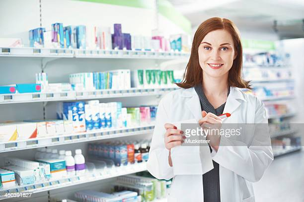 Female pharmacist looking into camera