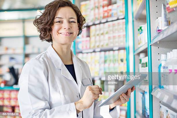 Female pharmacist with a digital tablet