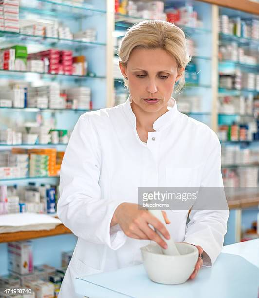 Female Pharmacist with Mortar and Pestle