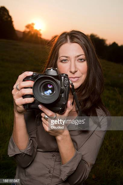 Female photographer in sunset
