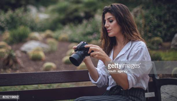 Female photographer in the public park