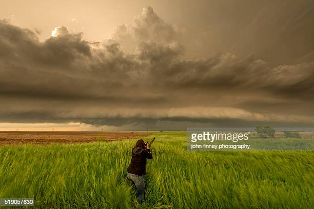 Female photographer on a storm, Kansas, USA.