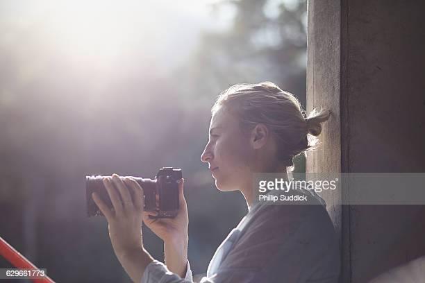 female photographer relaxing in hazy backlight