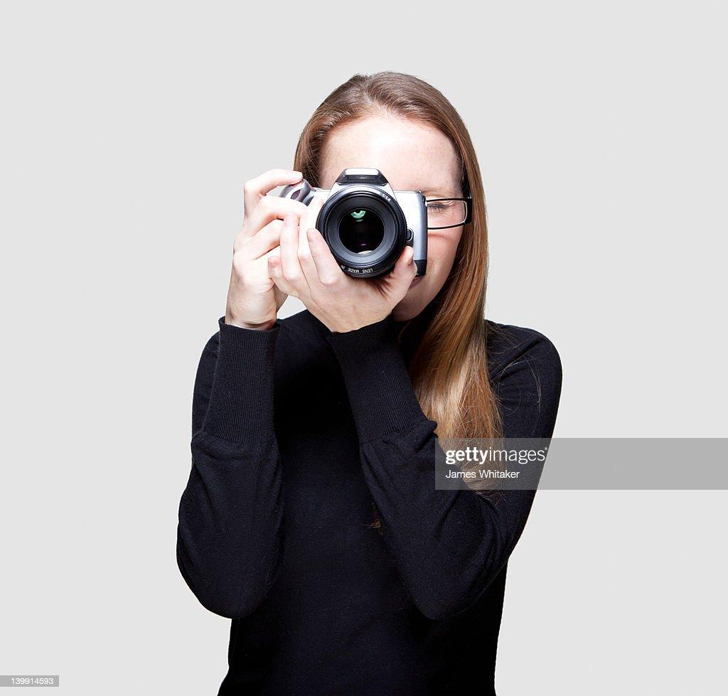 Female Photographer takes photo : Stock Photo