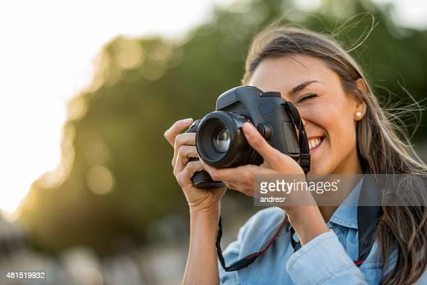 Female photographer taking pictures outdoors