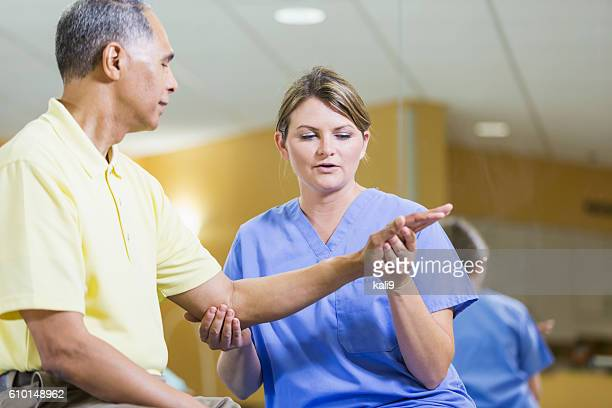 Female physical therapist, African American patient