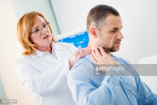 Female Physical Therapist Examines the Patient's Neck