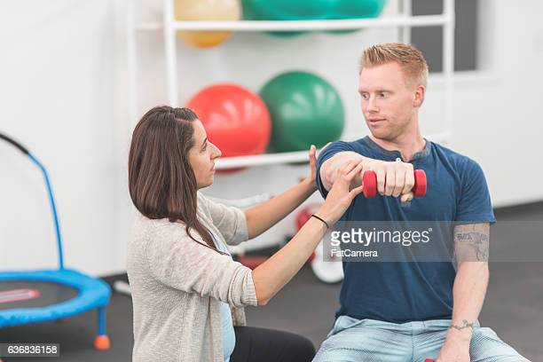 Female physical therapist working with an adult patient