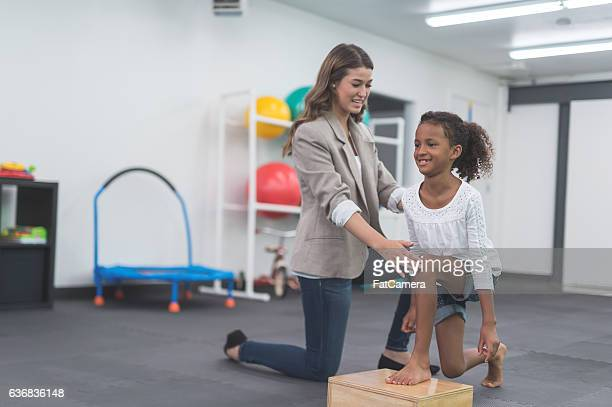 A female physical therapist working with an ethnic