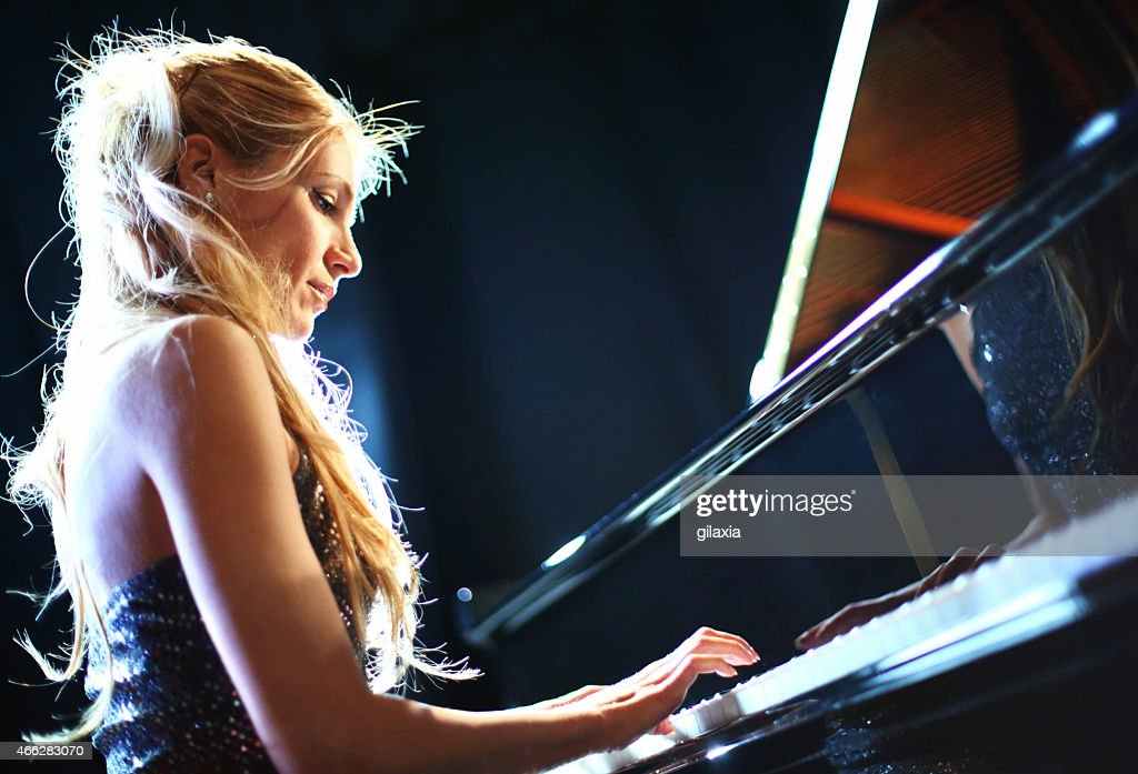 Female piano soloist in a concert.