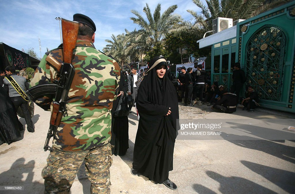 A female pilgrim takes part in the Arbaeen religious festival which marks the 40th day after Ashura commemorating the seventh century killing of Prophet Mohammed's grandson, Imam Hussein, in the shrine city of Karbala, southwest of Iraq's capital Baghdad, on January 1, 2013.