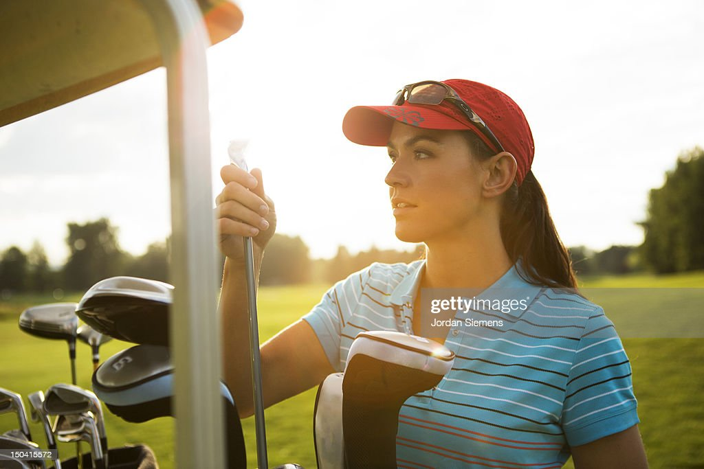 A female playing a round of golf. : Stock Photo