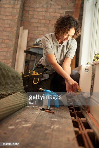 female plumber radiator installation
