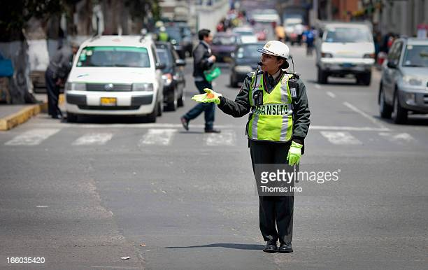 A female police officer directing traffic