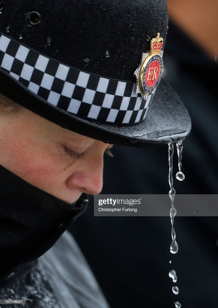A female police officer takes part in a one minutes silence during a memorial vigil at the scene where PC Nicola Hughes and PC Fiona Bone were murdered one week ago, in Mottram on September 25, 2012 in Manchester, England. Members of the public joined police officers in a walk from Hyde police station to the scene of the killings, for a vigil of prayers and reflection. Dale Cregan, 29, appeared before Manchester Magistrates last week accused of four murders, including those of PC Nicola Hughes and PC Fiona Bone on September 18, and also in two separate attacks earlier this year on Mark Short and his father David Short. Cregan is also being charged with an additional four counts of attempted murder.