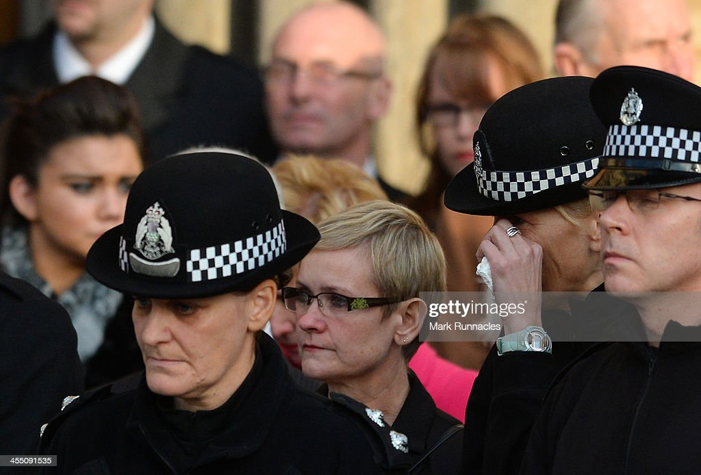 A female police officer wipes a tear from her eye during the funeral service at St Andrews Cathedral for PC Kirsty Nelis who was killed in the Clutha...