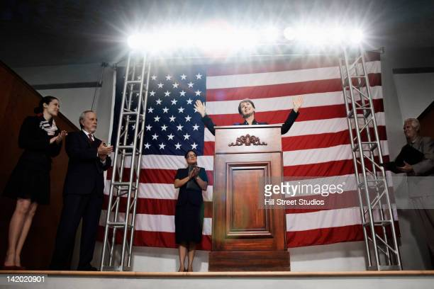 Female politician making speech at podium