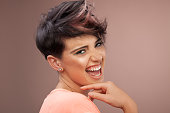 Portrait of happy female with short hair
