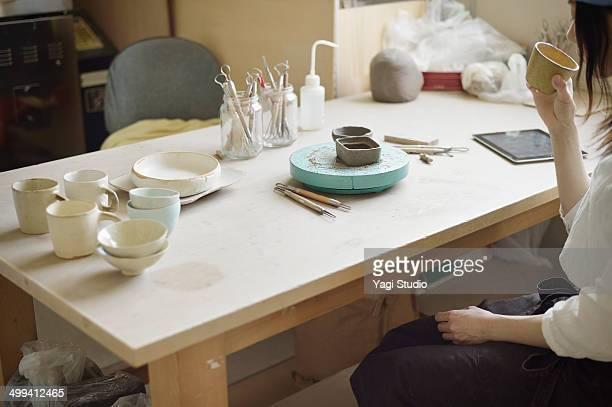 Female Potter working in studio