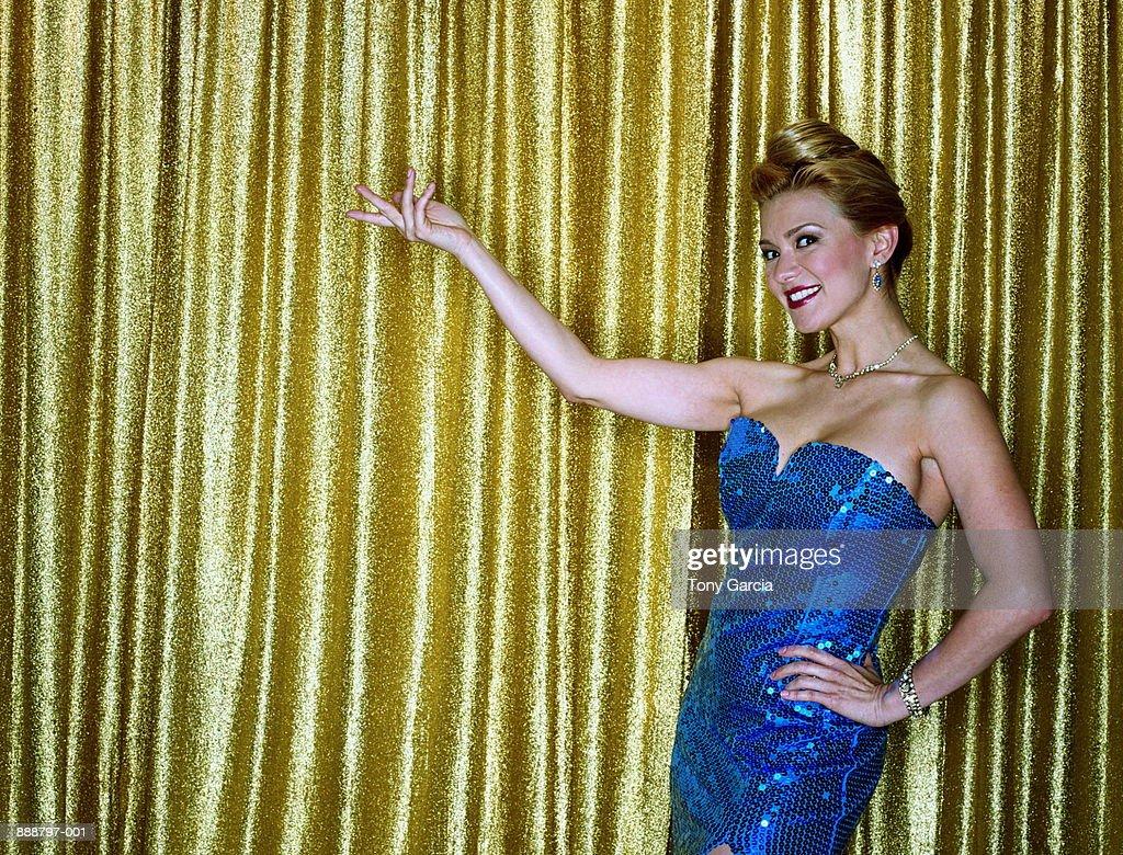 Female presenter in blue sequinned dress (cross-processed)