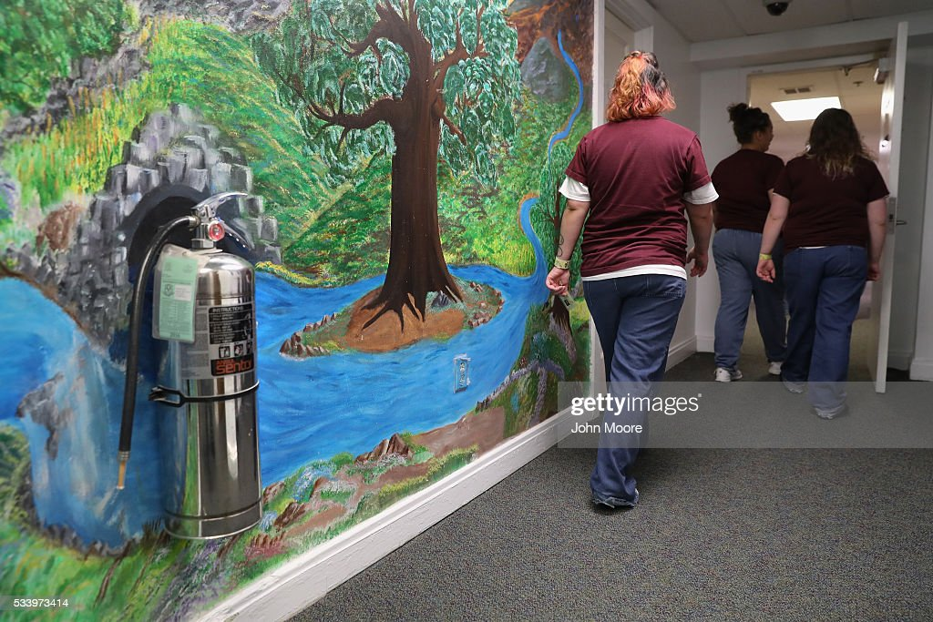 Female prisoners walk through a corridor at the York Community Reintegration Center on May 24, 2016 in Niantic, Connecticut. The facility is part of the York Correctional Institution, which houses all of the state's more than 1,000 female inmates. The unit is designed to prepare prisoners for successful reintegration into society after serving out their sentences. Criminal justice and prison reforms are taking hold with bi-partisan support nationwide in an effort to reduce prison populations, while saving taxpayer money. The state's criminal justice reforms are part of Connecticut Governor Dannel Malloy's 'Second Chance Society' legislation.