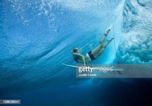 Female Pro surfer at Cloud Break Fiji